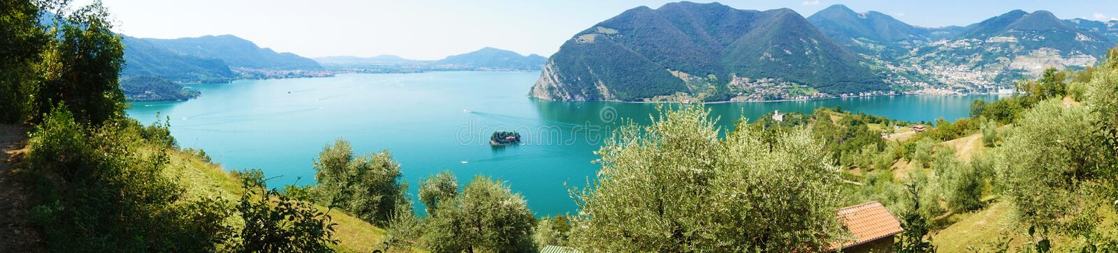 Panoramic view of mountain lake with island in the middle. Panorama from Monte Isola Island with Lake Iseo. Italian landscape. stock photos