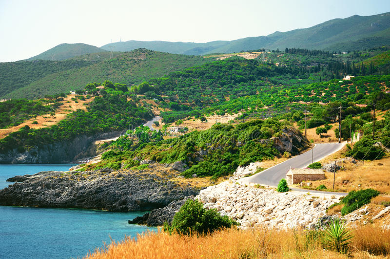 Panoramic view on mountain landscape with olive groves stock photography