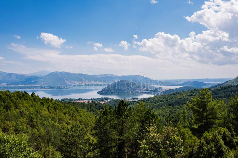 Panoramic view on the mountain and sunset in the Kastoria and Orestias lake. Greece royalty free stock photos