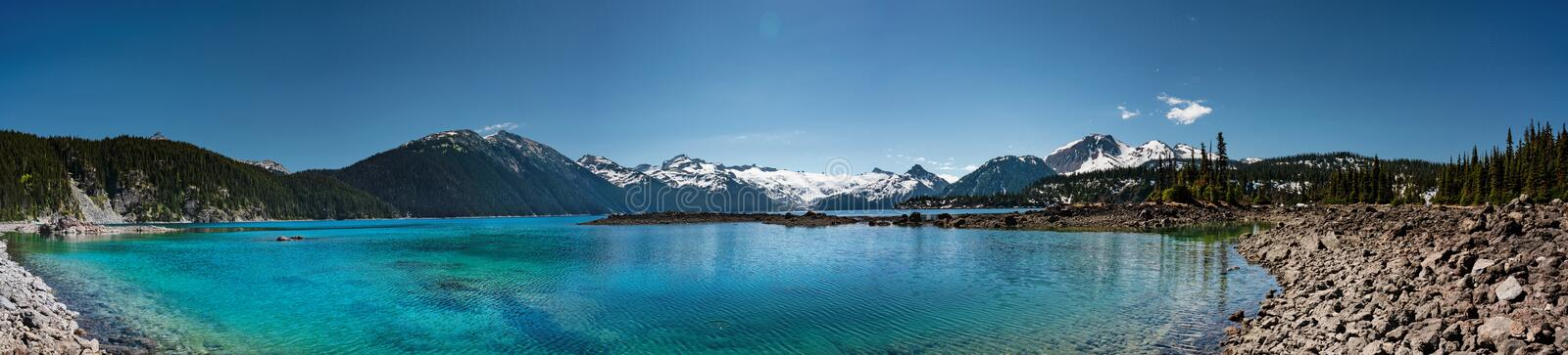Panoramic view of mountains and turquoise coloured lake in Garibaldi provincial park. BC, Canada stock image
