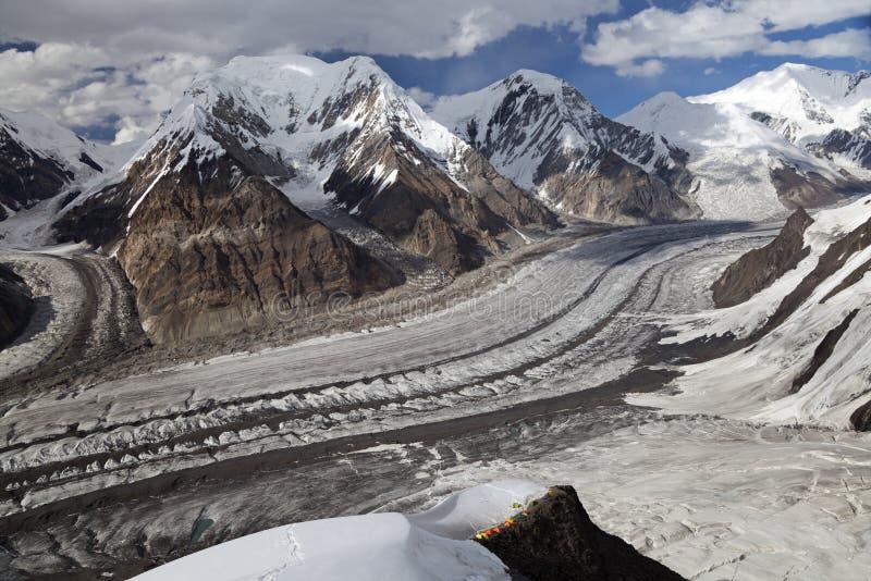 Panoramic view from mountainside of Khan Tengri peak, North Inylchek glacier, Tian Shan mountains royalty free stock image