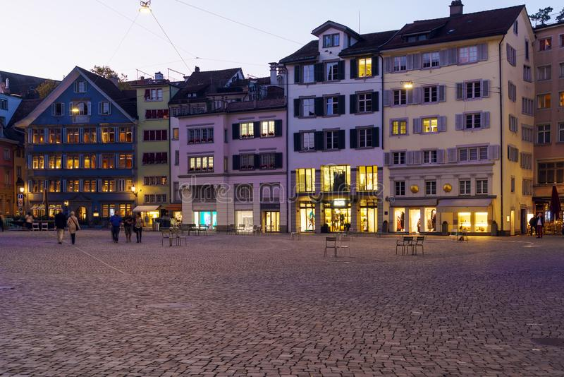 Panoramic view of Munsterhof square with Guild houses at night, royalty free stock photography
