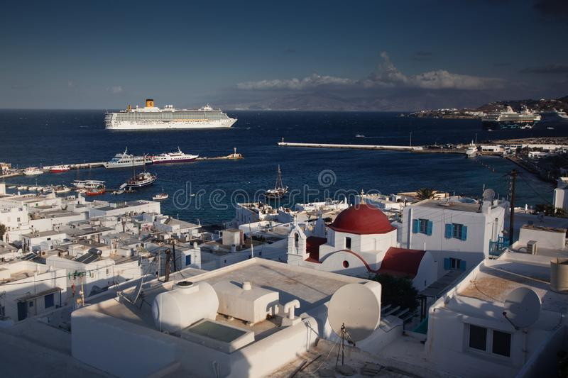 Panoramic view of the Mykonos town harbor from the above hills on a sunny summer day, Mykonos, Cyclades, Greece. Panoramic view of Mykonos town harbor from the stock images