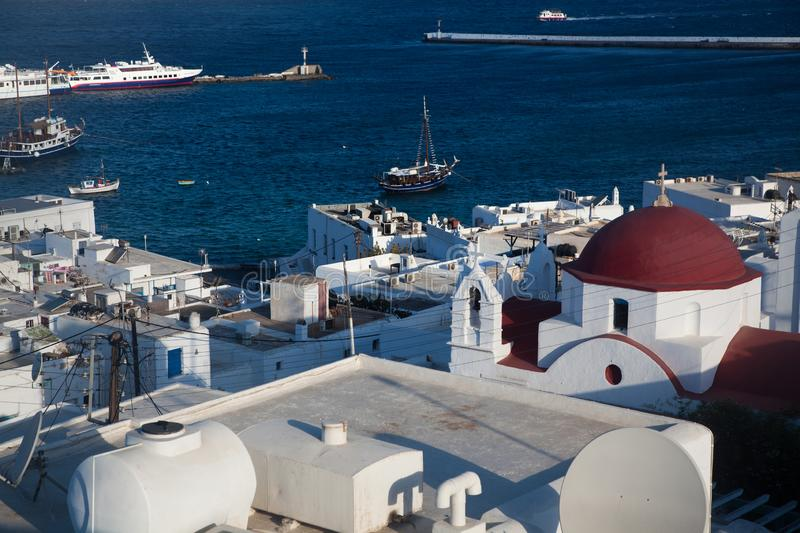 Panoramic view of the Mykonos town harbor from the above hills on a sunny summer day, Mykonos, Cyclades, Greece. Panoramic view of Mykonos town harbor from the royalty free stock images