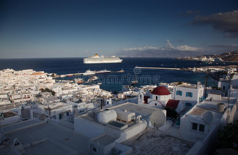 Panoramic view of the Mykonos town harbor from the above hills on a sunny summer day, Mykonos, Cyclades, Greece. Panoramic view of  Mykonos town harbor from the stock photo