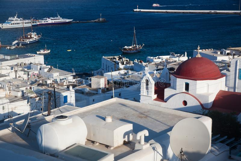 Panoramic view of the Mykonos town harbor from the above hills on a sunny summer day, Mykonos, Cyclades, Greece. Panoramic view of  Mykonos town harbor from the stock photos
