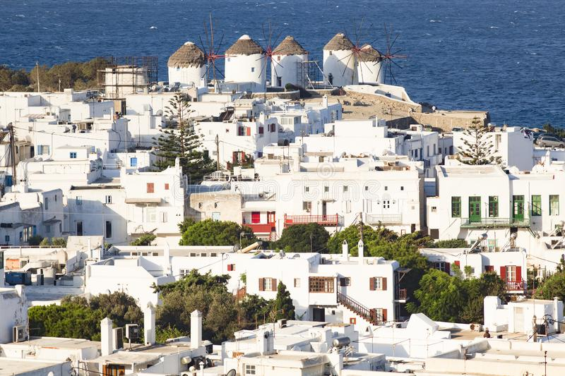 Panoramic view of the Mykonos town harbor from the above hills on a sunny summer day, Mykonos, Cyclades, Greece. Aegean, architecture, beach, beautiful, blue stock photo