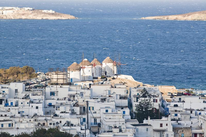 Panoramic view of the Mykonos town harbor from the above hills on a sunny summer day, Mykonos, Cyclades, Greece. Aegean, architecture, beach, beautiful, blue royalty free stock photo