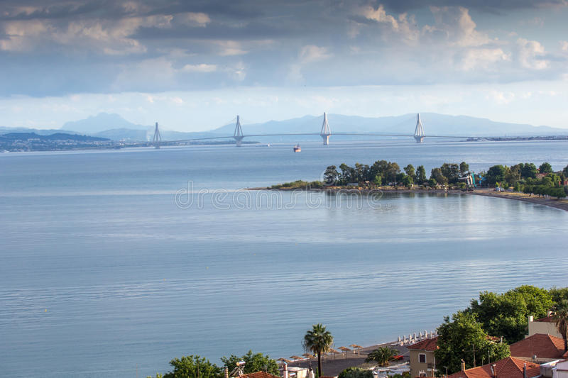 Panoramic view of Nafpaktos town and cable bridge between Rio and Antirrio, Greece. Panoramic view of Nafpaktos town and cable bridge between Rio and Antirrio stock photography