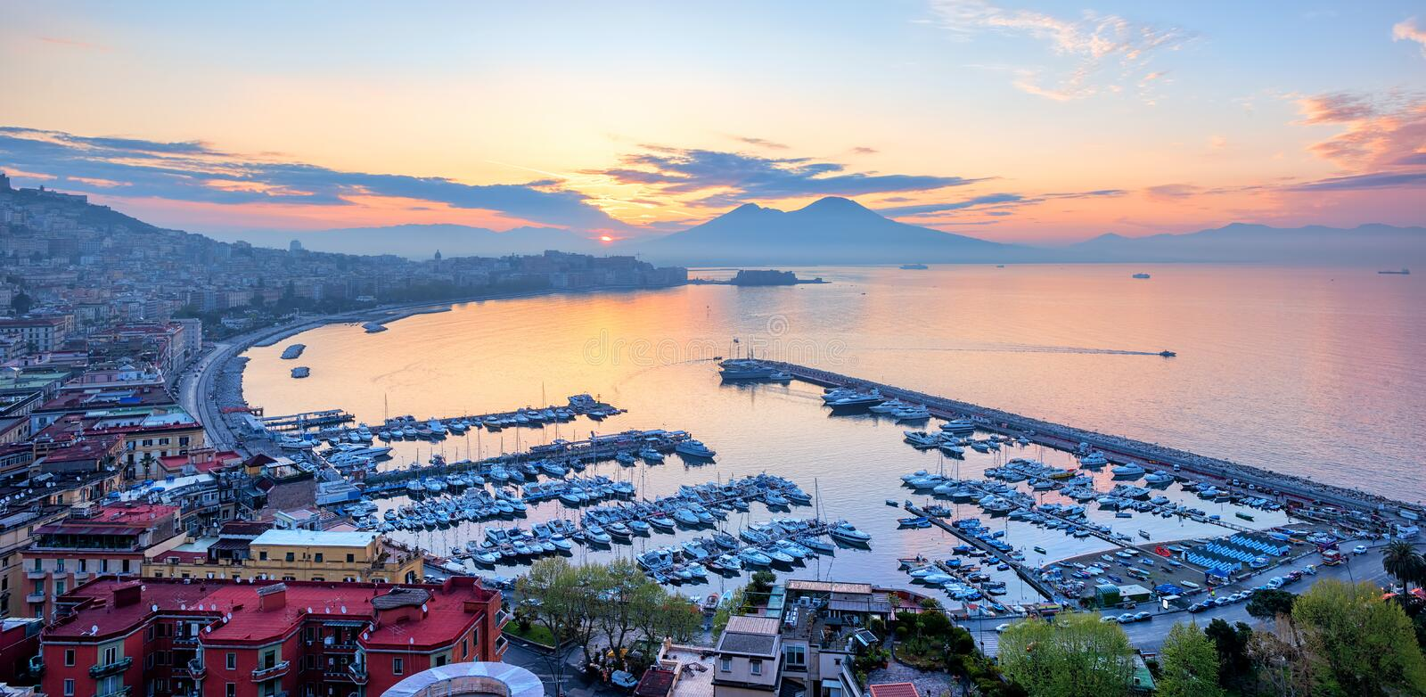 Panoramic view of Naples city, Italy, at sunrise stock photos