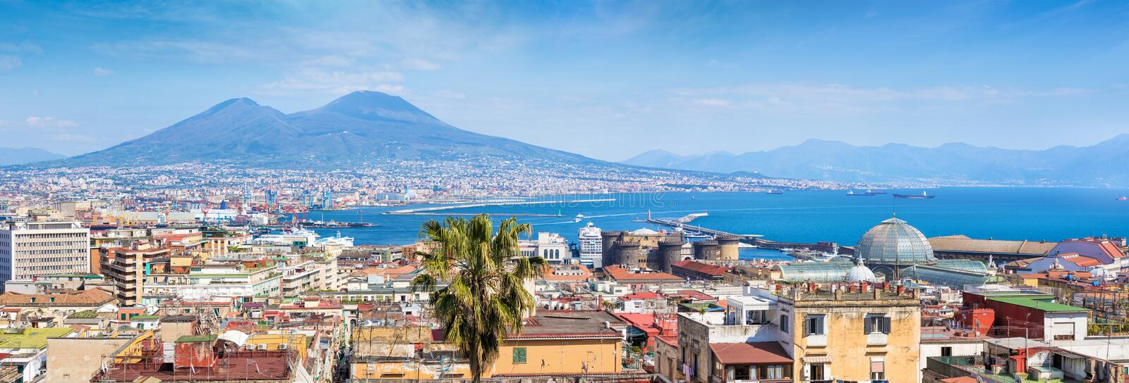 Panoramic view of Naples, Italy. Castel Nuovo and Galleria Umberto I towering over roofs of neighboring houses of Naples. And located in foreground. Mount royalty free stock photos
