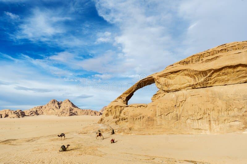 Panoramic view of natural rock bridge and Wadi Rum desert, Jordan stock photo