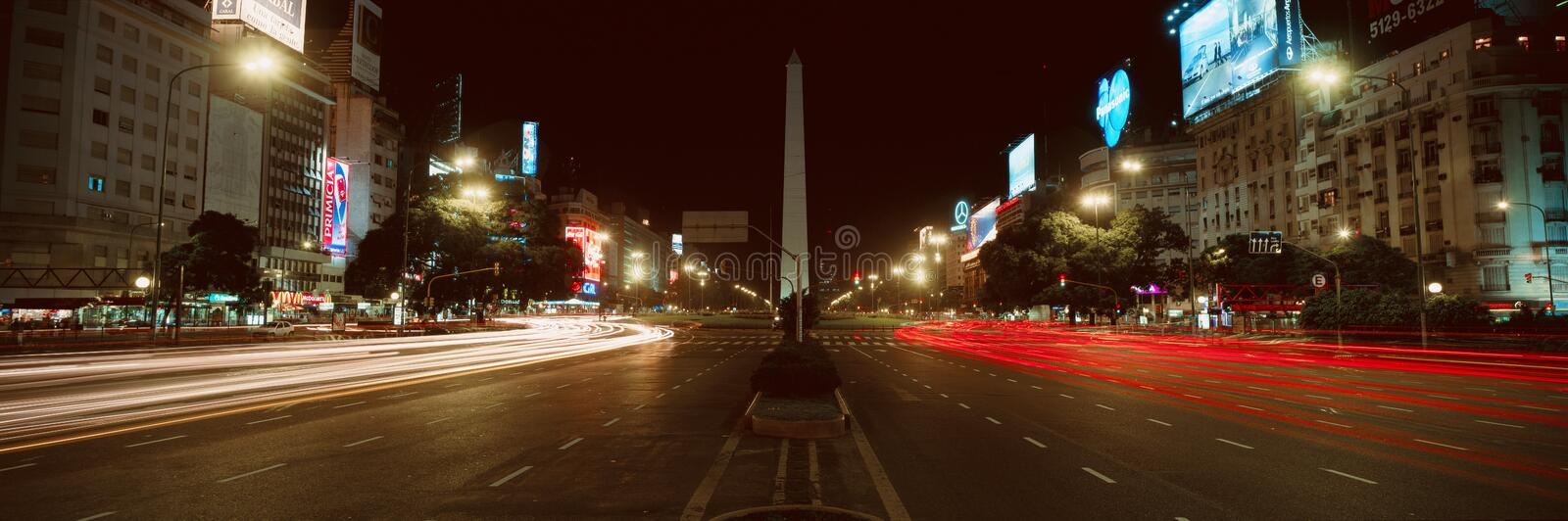 Panoramic view at night of Avenida 9 de Julio, widest avenue in the world, and El Obelisco, The Obelisk, Buenos Aires, Argentina royalty free stock image