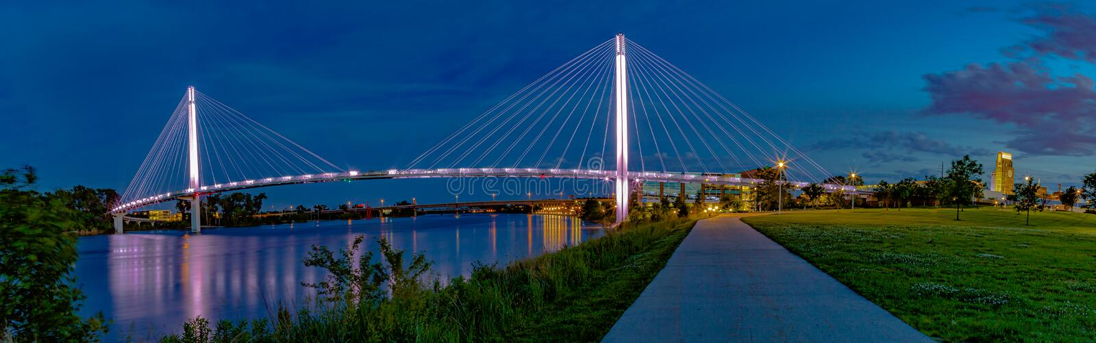 Panoramic view Night scene of Bob Kerrey pedestrian bridge Omaha royalty free stock images