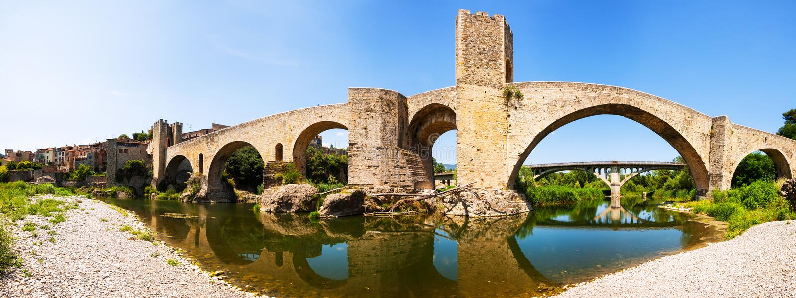 Panoramic view of old bridge over Fluvia river in Besalu stock photography