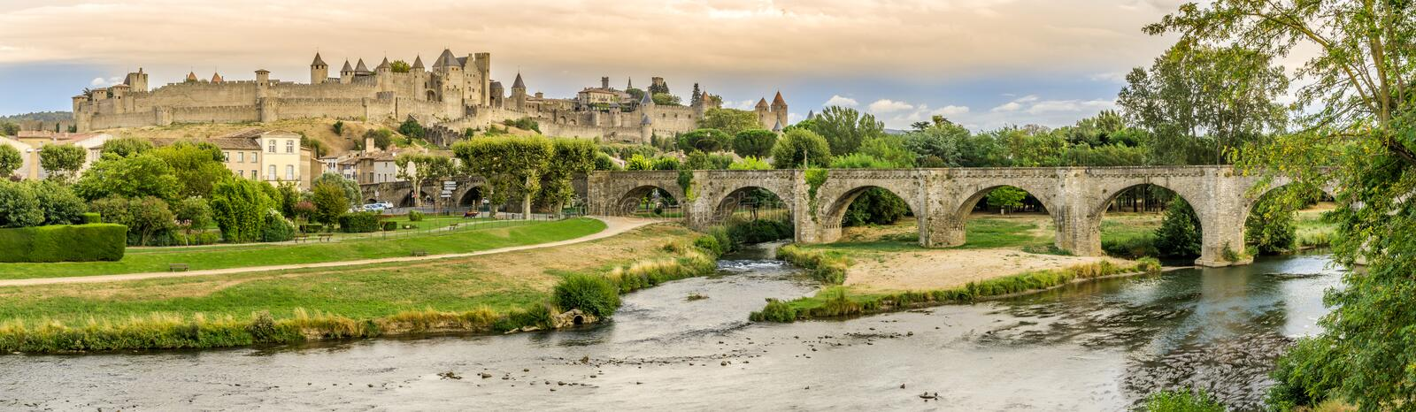 Panoramic view at the Old City of Carcassonne with Old Bridge over L Aude river - France stock images