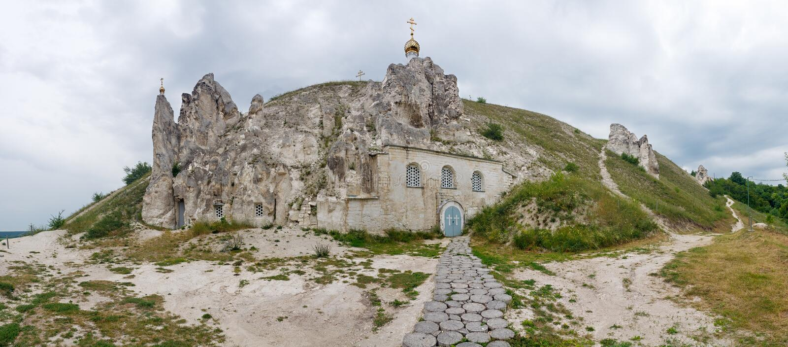 Panoramic view of the old Orthodox church inside the mountain of chalk stock photo
