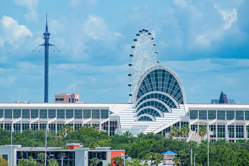 Panoramic view of Orlando Convention Center, Sky Flyer and the Big Wheel 1. Orlando, Florida.  July 01, 2019  . Panoramic view of Orlando Convention Center, Sky stock photography