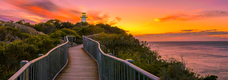 Panoramic view over Cape Tourville Lighthouse at sunrise. Cape Tourville Lighthouse at sunrise, Freycinet Peninsula, Tasmania royalty free stock photo
