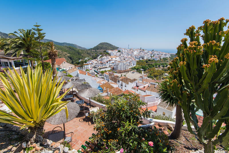 Panoramic view over Frigiliana white village,Spain stock images