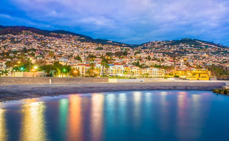 Panoramic view over Funchal – Madeira island. Panoramic view over Funchal illuminated in evening lights in Madeira island, Portugal royalty free stock image