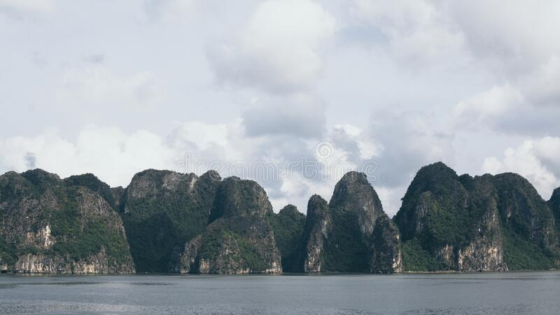 Panoramic view over limestone mountains in Halong Bay, Vietnam. Ocean, boat, tour, sea, vietnamese, ride, northern, beach, holiday, vacation, trip, adventure royalty free stock photography
