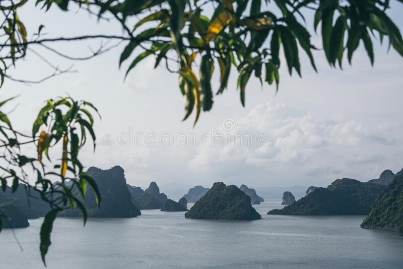 Panoramic view over limestone mountains in Halong Bay, Vietnam. Ocean, boat, tour, sea, vietnamese, ride, northern, beach, holiday, vacation, trip, adventure royalty free stock image