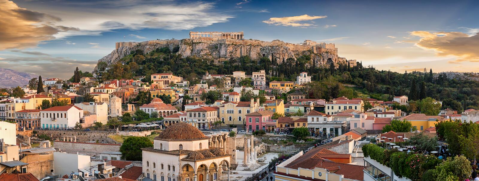 Panoramic view over the old town of Athens and the Parthenon Temple of the Acropolis. During sunset royalty free stock image