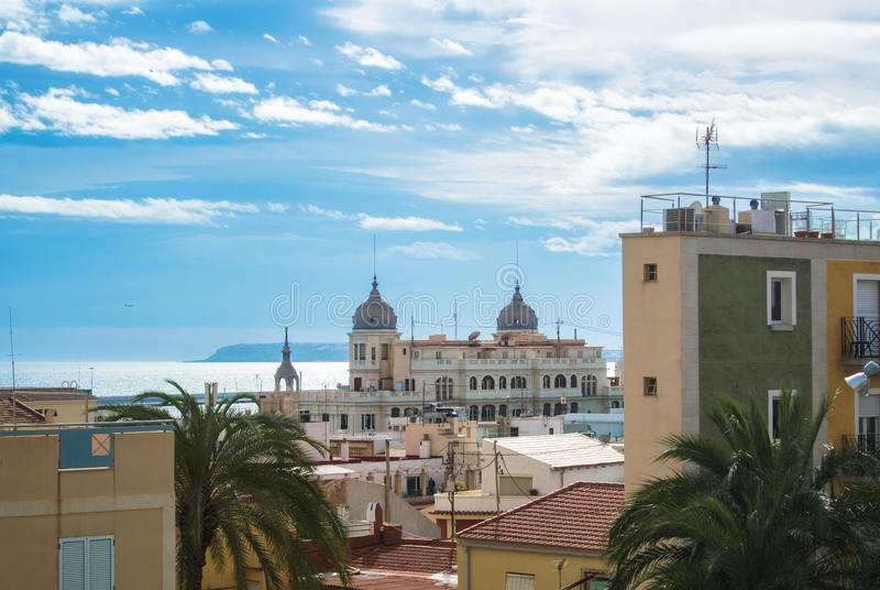 Panoramic view over the roofs of Alicante, buildings near promenade and Mediterranean sea royalty free stock images