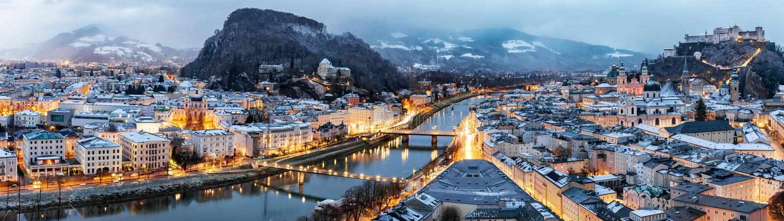 Panoramic view over Salzburg, Austria in winter time. Panoramic view over Salzburg, Austria, in the evening with city lights in winter time stock photo