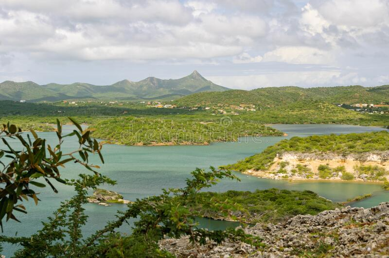 View over Santa Martha Bay in Curacao with Mount Christoffel in the background stock photography