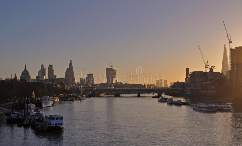 Panoramic view over Thames river from Waterloo bridge in the evening. royalty free stock photos