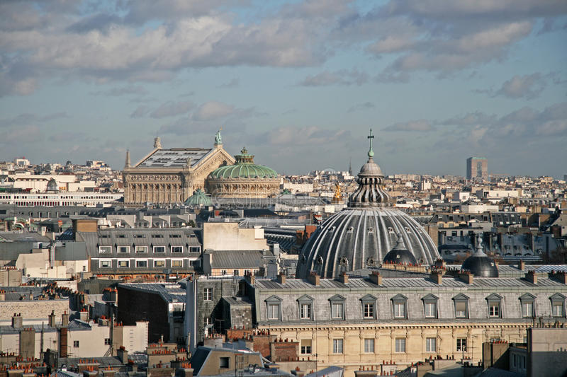 Panoramic view of Paris from the ferris wheel. The Opera Garnier is on the left in the distance and Church of the Assumption on stock image