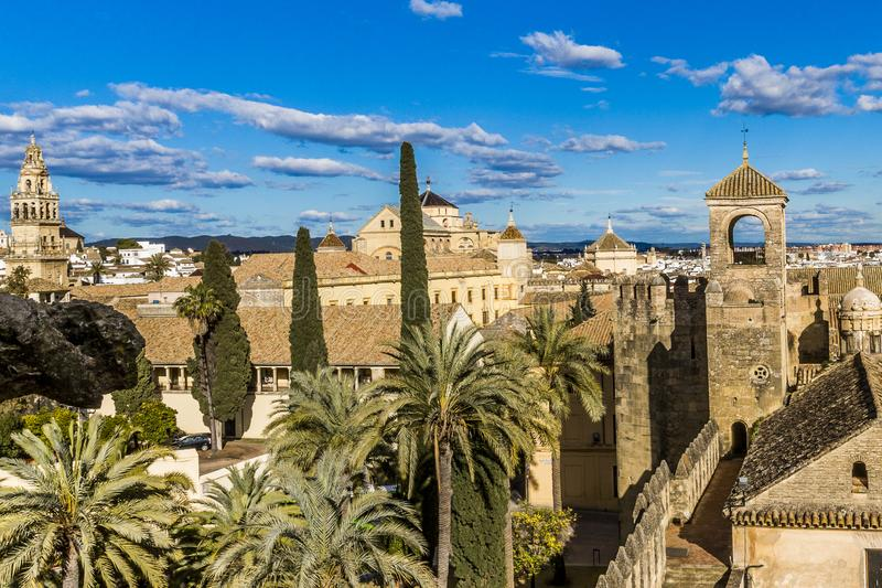 Panoramic view of a part of the city of Cordoba with palm trees and a tower of a church stock image