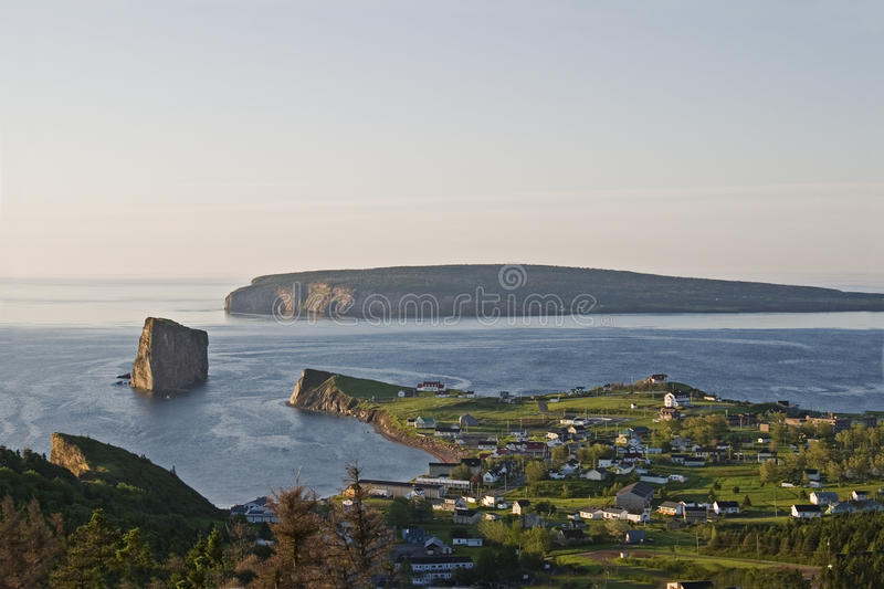 Panoramic view of Perce village and Perce Rock, Gaspe. A Panoramic view of Perce village and Perce Rock, Gaspe stock images