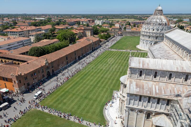 Panoramic view of Piazza del Miracoli with Pisa Cathedral and Baptistery royalty free stock photography