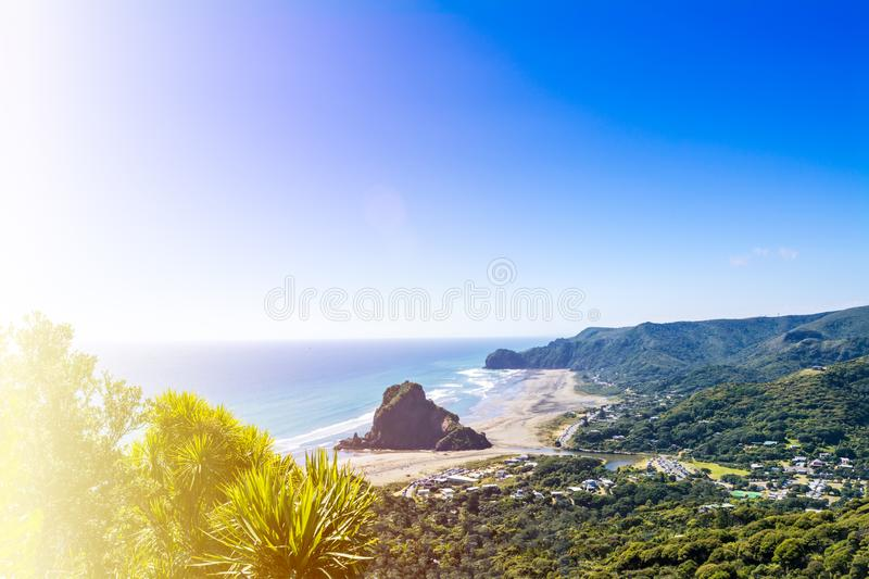 Panoramic view of Piha beach and the adjacent valley on the West coast of Auckland, New Zealand. Beautiful summer day royalty free stock images