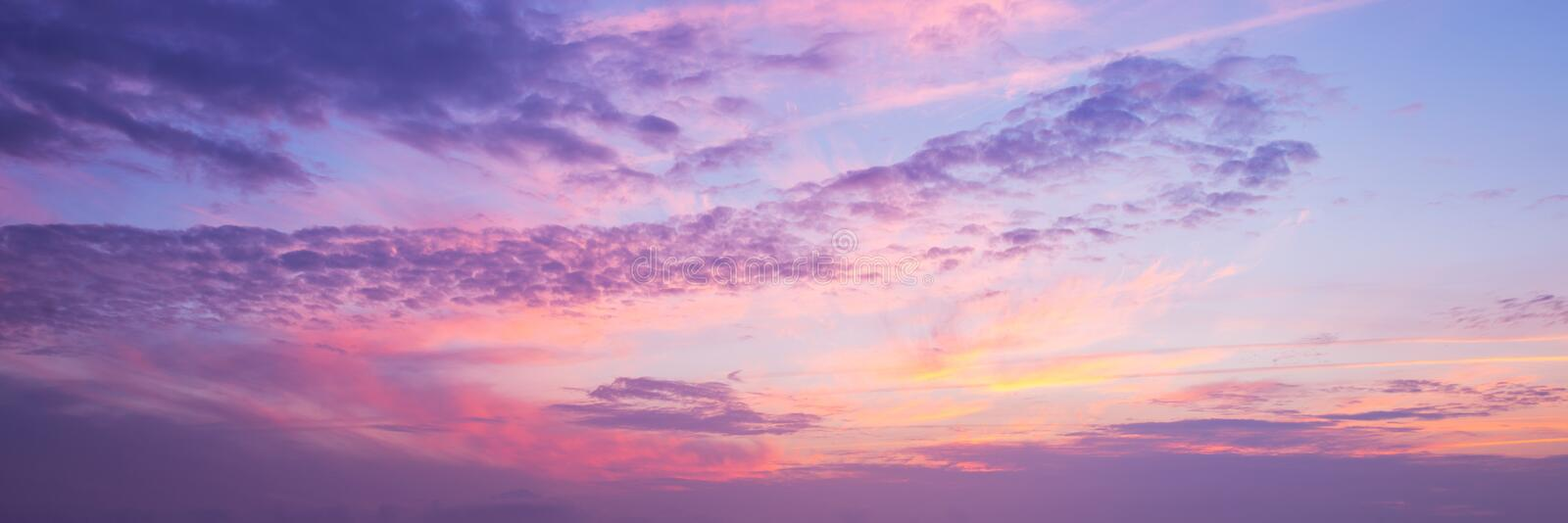Panoramic view of pink and purple sky at sunset. Panoramic view of a pink and purple sky at sunset royalty free stock photo