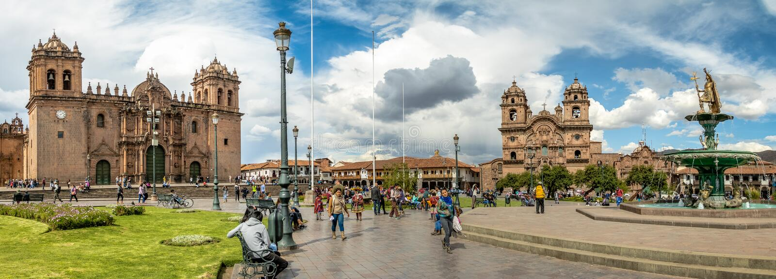 Panoramic view of Plaza de Armas with Inca fountain, Cathedral and Compania de Jesus Church - Cusco, Peru stock photography