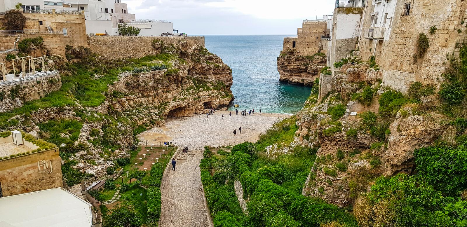 Panoramic view of of Polignano a Mare beach,  town on the rocks, Italian town of the metropolitan city of Bari in Puglia region,. Italy stock photography