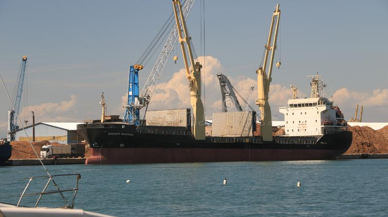 Panoramic view of the port. A Cargo ship and a ferry are anchore stock photos