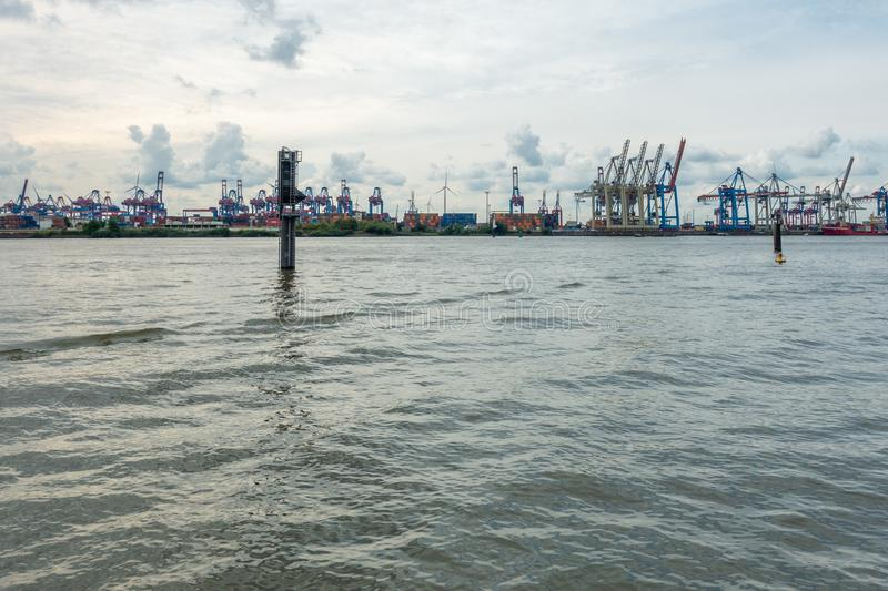 Panoramic view of the port of Hamburg in cloudy weather. A panoramic view of the port of Hamburg in cloudy weather royalty free stock photo