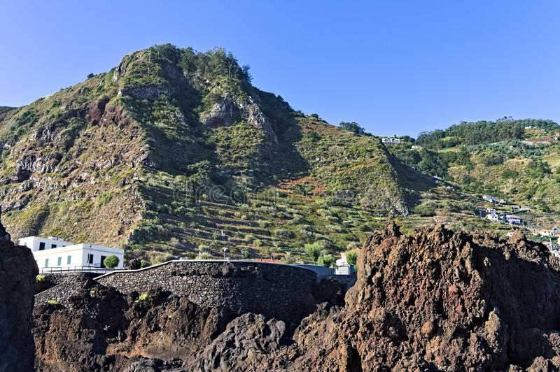 Panoramic view of Porto Moniz, a small village in the Atlantic coast of Madeira island with terraced fields stock image