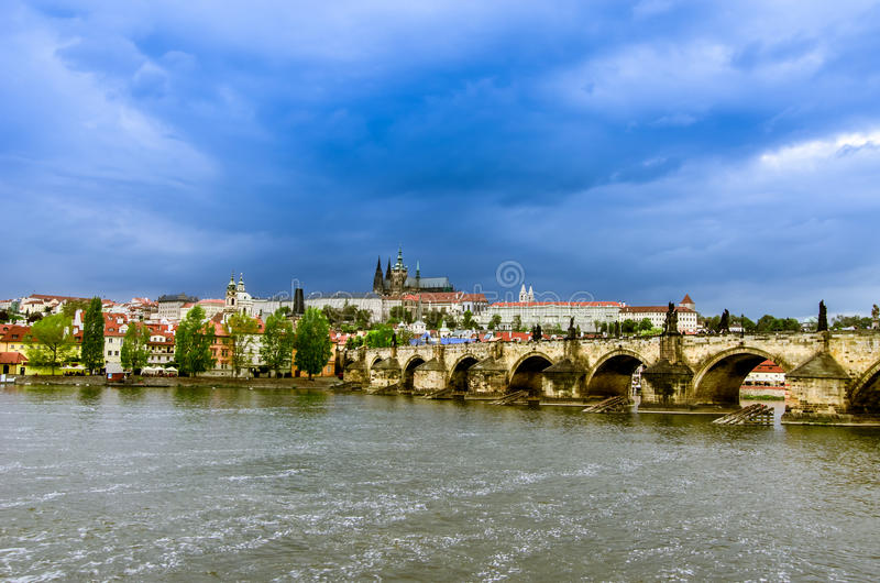 Panoramic view of Prague over the Vltava river and Charles Bridge royalty free stock images