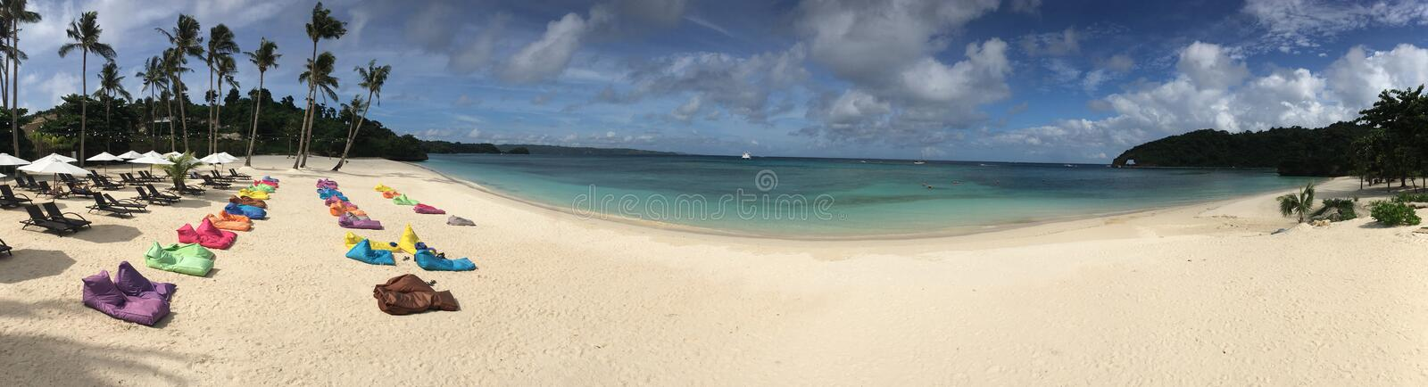 Panoramic view of private Llig Lligan Beach at Boracay Island. This is a beautiful secluded beach in the less touristic north east area of Boracay. The beach has royalty free stock photos