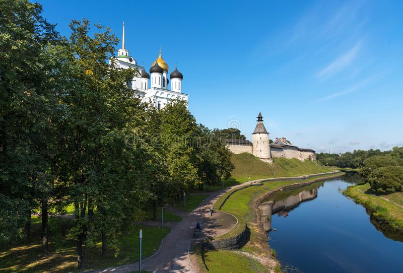 Panoramic view of Pskov Kremlin on the Velikaya river. Ancient fortress. The Trinity Cathedral in summer. Pskov. Russia royalty free stock photo