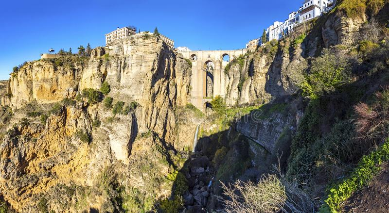Panoramic view of Puente Nuevo bridge and old houses built on the edge of the cliff, in ancient city of Ronda, province of Malaga stock photo