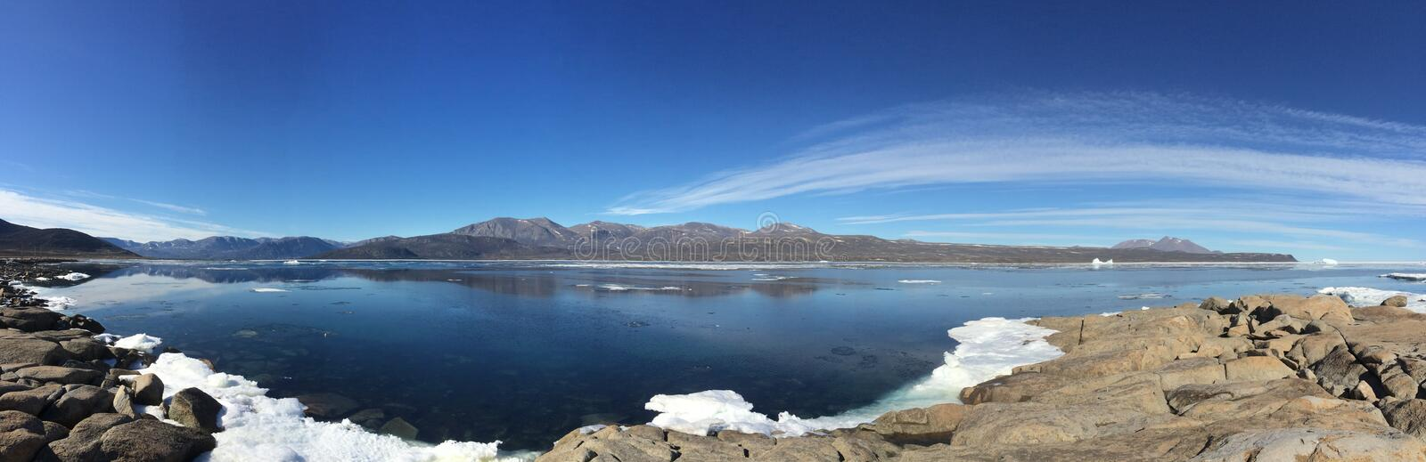 A panoramic view from Qikiqtarjuaq, a Inuit community in the high Canadian arctic located on Broughton Island. Nunavut Canada royalty free stock image