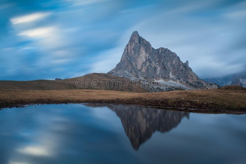 Panoramic view of Ra Gusela peak in front of mount Averau and Nuvolau, in Passo Giau, high alpine pass near Cortina d`Ampezzo stock photography