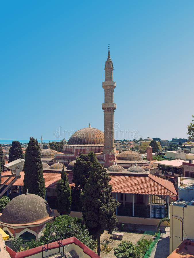 Panoramic view of rhodes town with the dome and minaret of the Suleiman mosque and city buildings against a blue summer sky stock photo